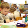 Photo: Boy draws in kindergarten