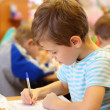 Drawing boy in kindergarten — Stock Photo