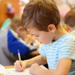 Drawing boy in kindergarten — Stock Photo #7423451