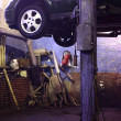 Car on lift in workshop — 图库照片 #7423563
