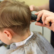 Boy cut in  hairdressing salon — Stock Photo