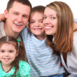 Closeup portrait of happy family — Stock Photo #7423701