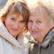Stock Photo: Elderly womand her daughter
