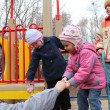 Elderly man with children on playground — Stock Photo