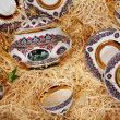 Tea-set in shavings - Stock Photo