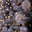 Christmas decorations and lights on New Year tree - Stock Photo