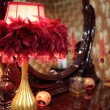 Lamp in feathers on toilet table — Stock Photo