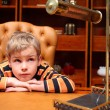 Boy sits in luxury office — Stock Photo