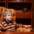 Boy sits in leather armchair in luxury office — Stock Photo #7424551