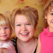 Girl with two children — Stock Photo #7424614