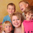 Young girl and four children — Stock Photo #7424618