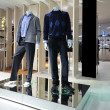 Manneqiuns in section of men clothes in shop — Stock Photo