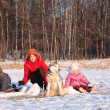 Mother with children and dog in wood in winter — Stock fotografie