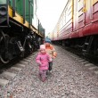 Two children between trains — Stock Photo
