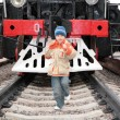 Stock Photo: Boy runs before locomotive