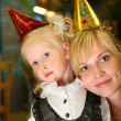 Mother with daughter on holiday in kindergarten — Stock Photo #7424908