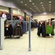 Entrance in clothes section in store — Stockfoto