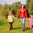 Mother with children on walk in wood, front view — Stock Photo #7425071