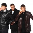 Businessman with two bodyguards — Stock Photo