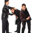 Two bodyguards protect businessman - Stock Photo