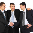 Businessman observes hand shake of two others — Stock Photo