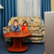 Two children watch tv — Stock Photo