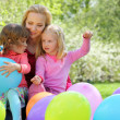 Royalty-Free Stock Photo: Mother, daughters and balloons in garden in spring
