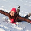 Young beauty woman lies on snow — Stock Photo