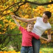 Mother with son to keep for hands in garden in spring — Stock Photo