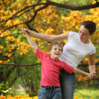 Mother with son to keep for hands in garden in spring — Stock Photo #7425604