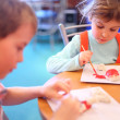 Children paint toys from clay - Foto Stock