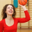 Young girl throws basketball ball — Stock Photo