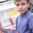 Boy in shop with  tool set in hands — Stockfoto