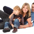 Happy parents with son laying — Stock Photo