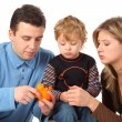 Father cleans to son an orange — Stock Photo