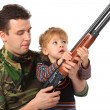 Father and son with gun — Stock Photo #7425931