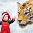 Boy in christmas hat and tiger collage — Stock Photo