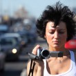 Girl with videocamera on highway — Stock Photo #7426612