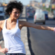 Young woman hitchhiking on highway — Stock Photo #7426621