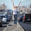 Girl jumps on highway middle — Stock Photo
