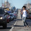 Girl dances on highway middle — Stock Photo #7426650
