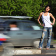 Girl stands on road among cars — Stock Photo