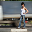 Girl stands on road among cars — Stock Photo #7426719