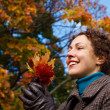 Girl with bunch of leaves in the park — Stock Photo #7426839