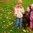 Mother with children in park — Stock Photo
