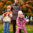 Mother with children in park — Stock Photo #7426854