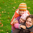 Mother with children in park — Stock Photo #7426881