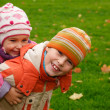Brother and sister walk in the park — Stock Photo