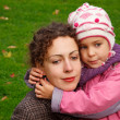Mother and daughter walking in park — Stock Photo #7426890