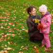 Mother and daughter playing in the park - Stock Photo